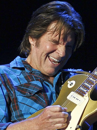 U.S. rock singer John Fogerty performs during the Peace & Love festival in Borlange in the Midwest of Sweden on July 3, 2010. AFP PHOTO / SCANPIX / NIKLAS LARSSON  **  SWEDEN OUT  ** (Photo credit should read NIKLAS LARSSON/AFP/Getty Images)